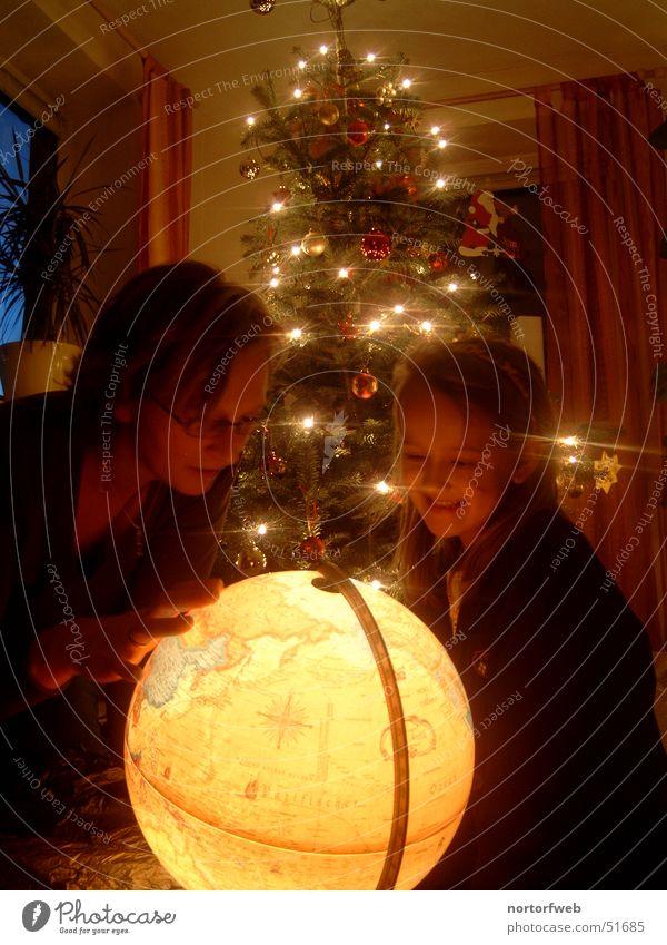 Child Family & Relations Christmas & Advent Joy Parents Light Moody Feasts & Celebrations Earth Gift Mother Fir tree Globe Interpretation Warm light