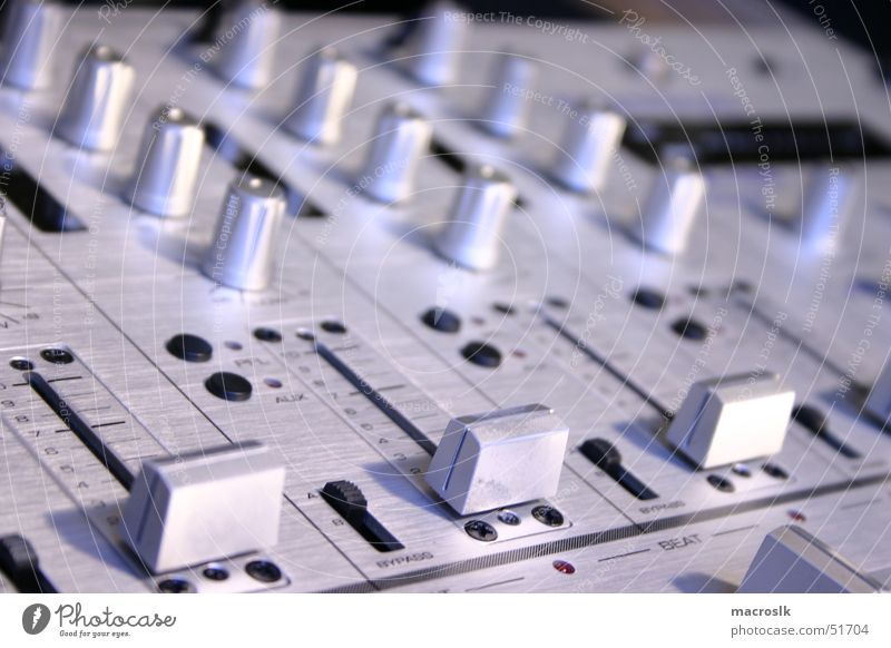 mixer in silver-blue Mixing desk Controller Black Lathe operator Event technology Loud Calm Easygoing Nightclub Cold Technical Blue tone Close-up Disc jockey
