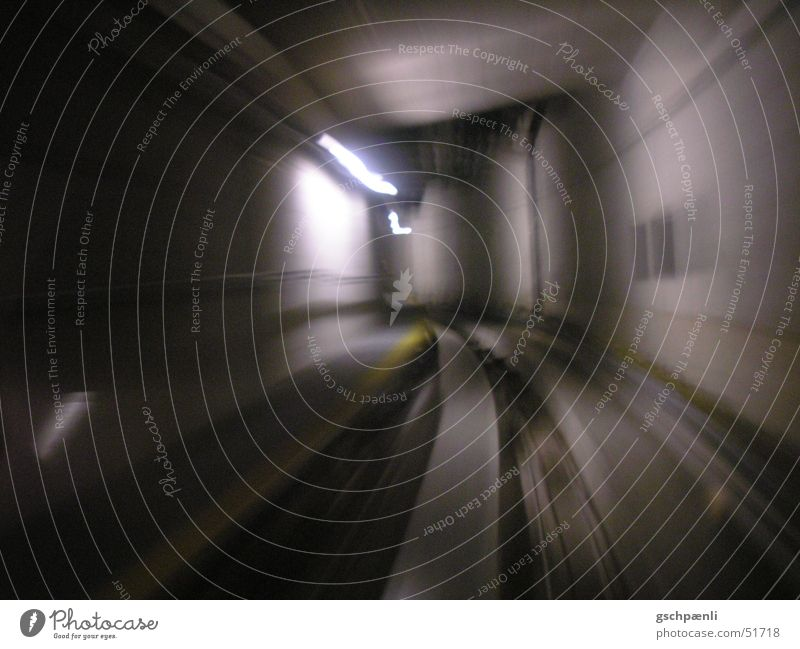tunnels Dark Speed Railroad Railroad tracks Underground Neon light Cold Heartless Yellow Stripe Long exposure Motion blur Dynamics Curve Distorted Movement