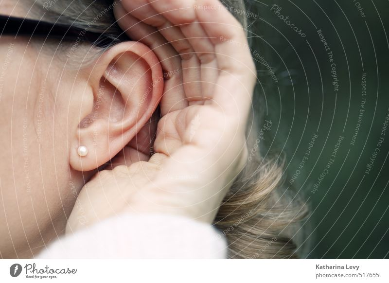 Listen Senses Calm Feminine Woman Adults Head Ear Hand 1 Human being Earring Blonde Long-haired Listening Authentic Natural Prompt Curiosity Surprise Noise