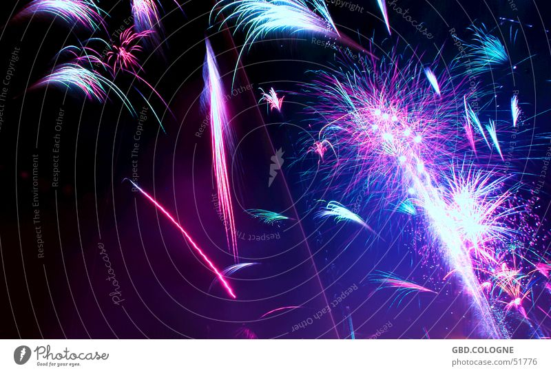 New Year's Eve 2005 Party Event Blue Multicoloured Violet Pink Black Firecracker Night shot 31.12. Colour photo Exterior shot Abstract Deserted Copy Space left