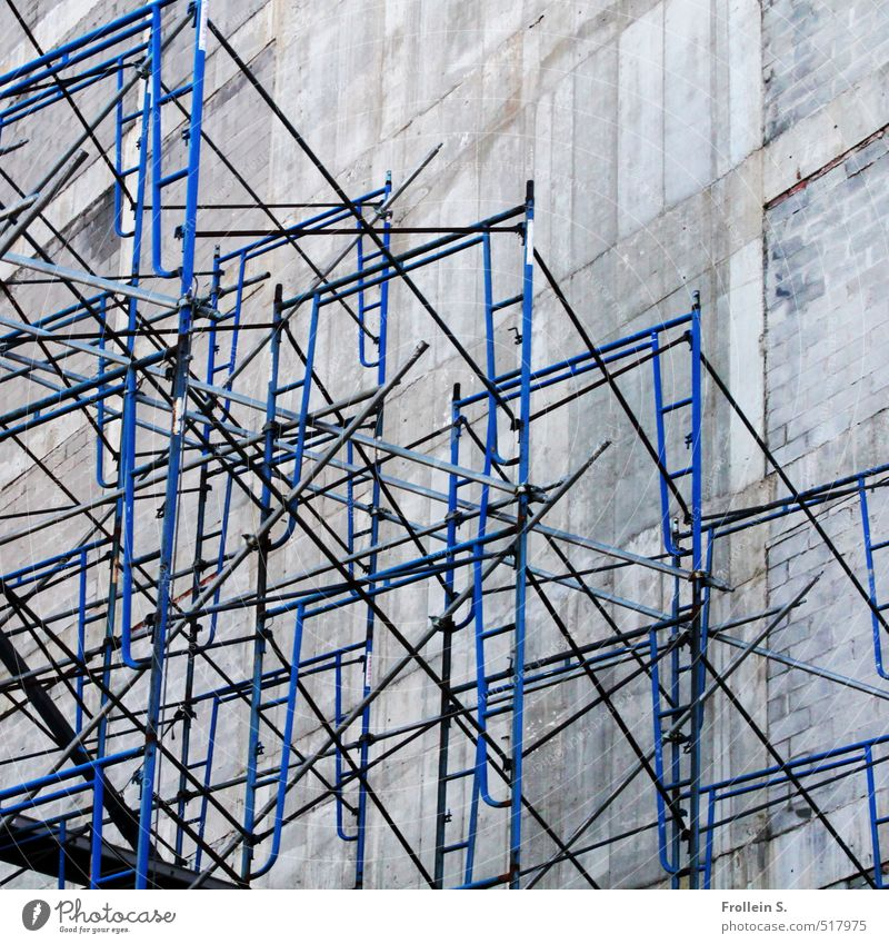 Constructive Wall (barrier) Wall (building) Scaffold Rod Ladder Scaffolding Concrete Metal Tall Gloomy Blue Dimension Perspective Line intricately Direct