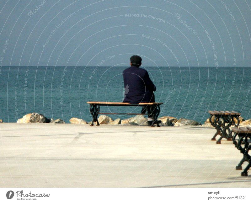 wanderlust Senior citizen Ocean Think Loneliness Wanderlust Beach Vacation & Travel Promenade Vantage point Man Horizon Grief Distress Male senior Bench Sky