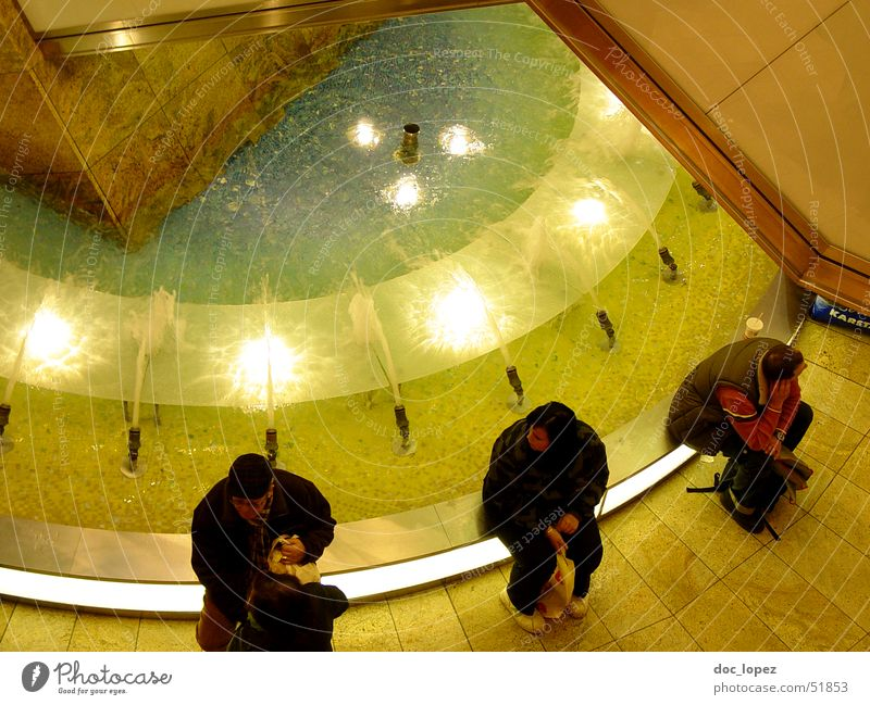 Human being Water Moody Wait Glittering Sit Perspective Well Visual spectacle Shopping malls Fountain