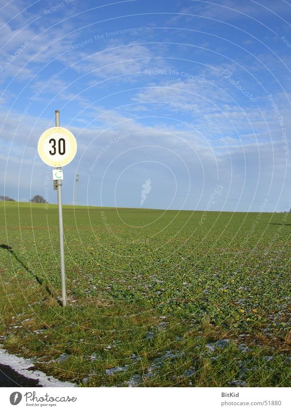 Sky Clouds Lanes & trails Landscape Field Signs and labeling Speed Americas 30 Road sign Kilometers per hour