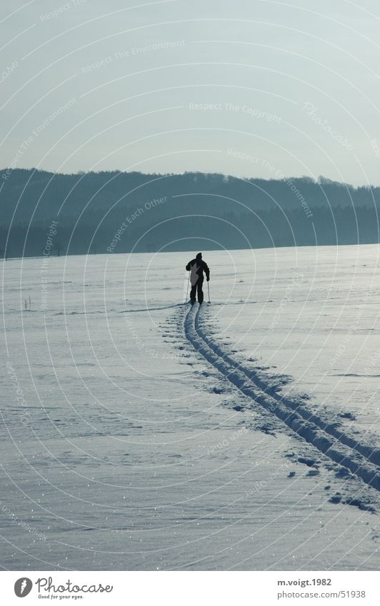 Human being Winter Loneliness Far-off places Sports Cold Snow Movement Ice Horizon Frost Fitness Skis Hill Wanderlust Winter vacation