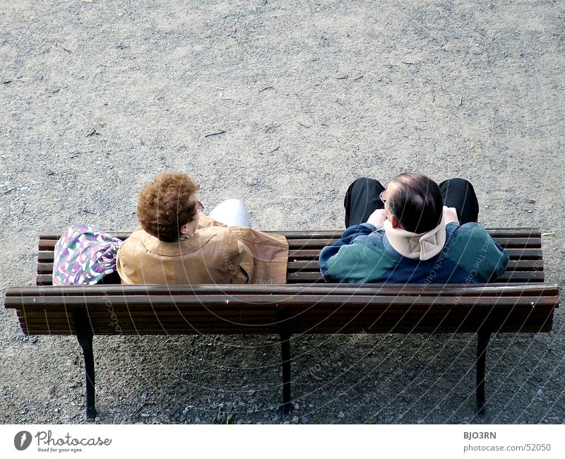 park guards Man Woman Married couple Neck collar Red-haired Wooden bench Gravel Partner Bench Couple Park bench Copy Space top Together Related Harmonious