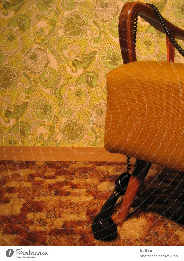Nobody here? Seventies Sixties Vintage car Retro Armchair Telephone Wall (building) Wallpaper Carpet Brown Green Pattern Floral wallpaper Telephone cable