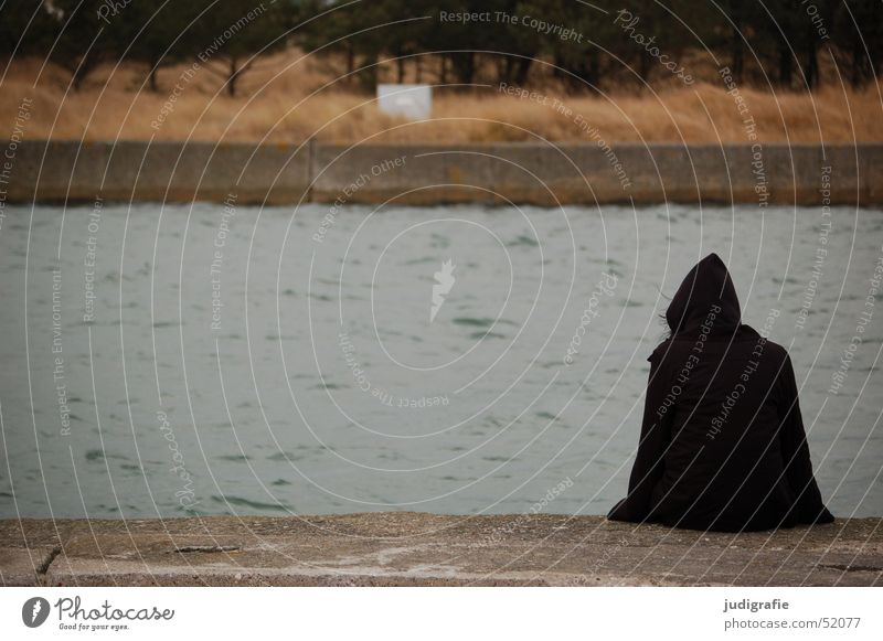 Human being Nature Water Ocean Winter Black Dark Cold Death Wait Concrete Sit Harbour Mysterious Jacket Jetty