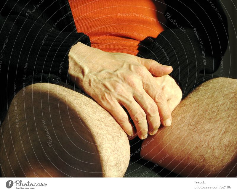 Human being Man Hand Calm Black Relaxation Orange Contentment Leisure and hobbies Sit Skin Chair T-shirt Serene Jacket
