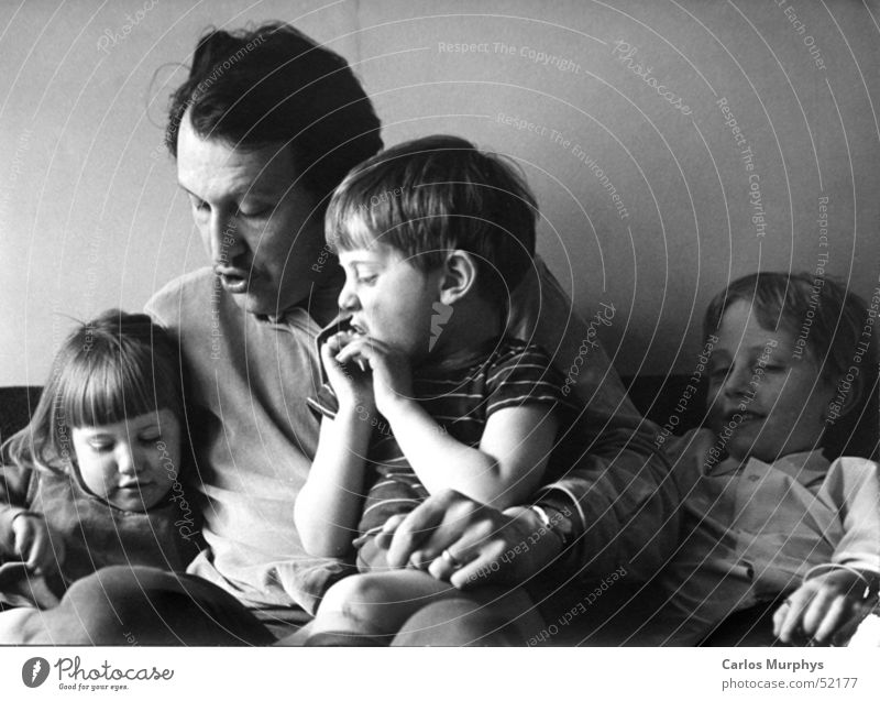 family stories Family & Relations Child Daughter Son Father Reading Read out loud Love Trust Calm Past Novella Black & white photo children To talk