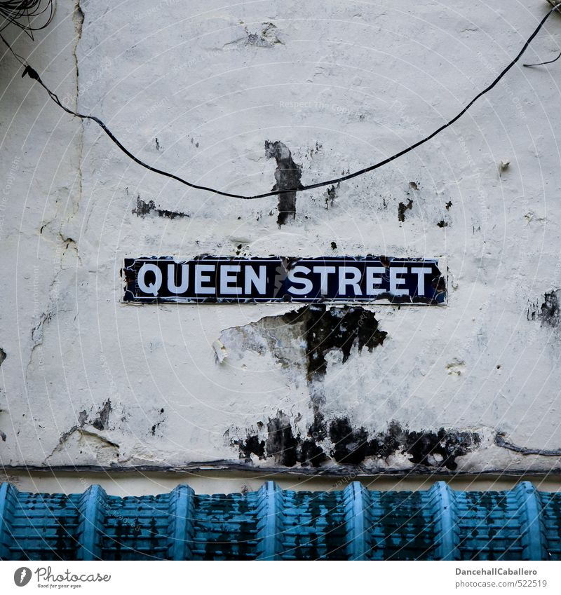 Blue Old Wall (building) Street Wall (barrier) Facade Dirty Transport Signs and labeling Signage Roof Transience Cable Historic Luxury Street art