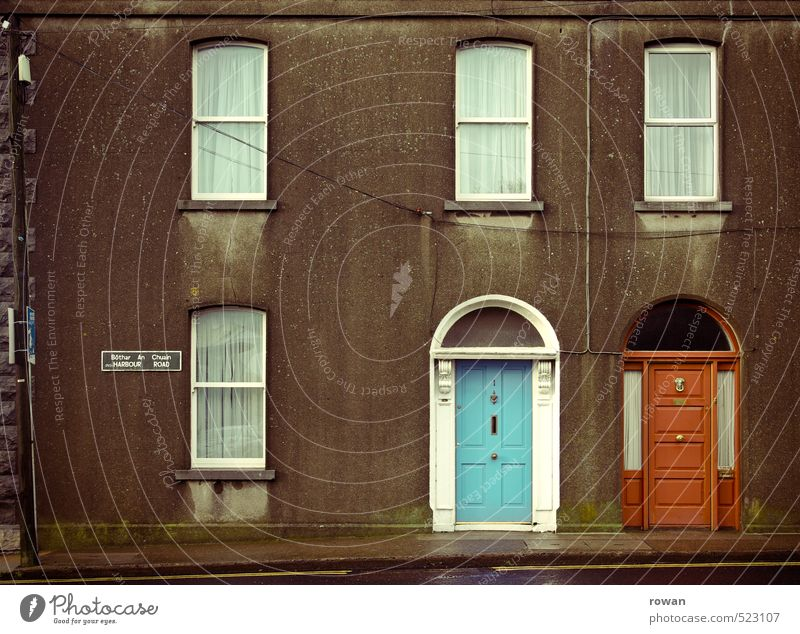 individuality House (Residential Structure) Detached house Wall (barrier) Wall (building) Facade Window Door Old Gloomy Town Blue Red Entrance Front door