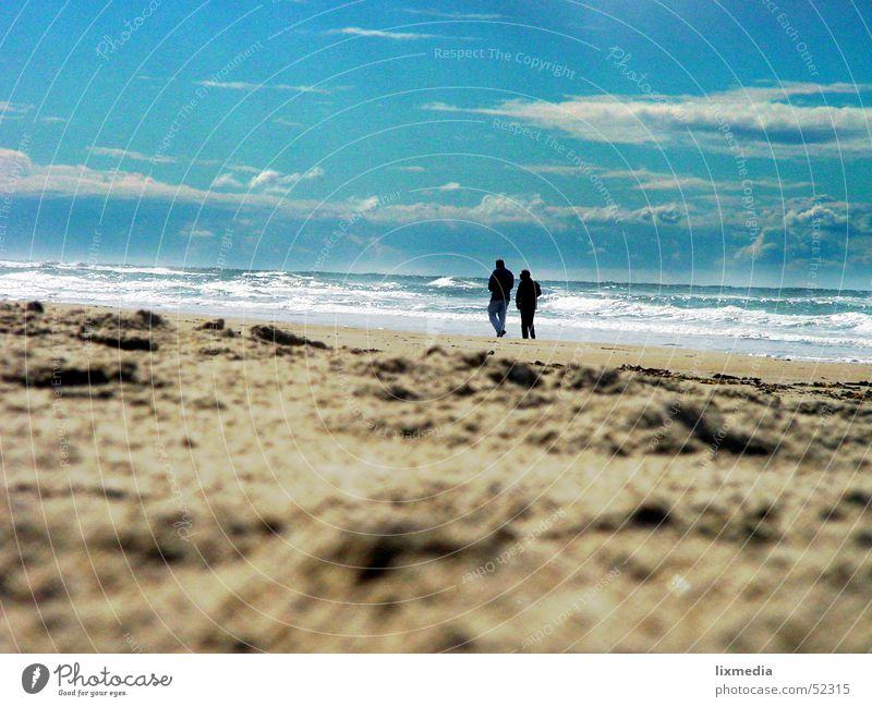 on the beach alone in pairs Beach Ocean Waves To talk Human being Woman Adults Man Couple Nature Sand Sky Clouds Together Longing 2 To go for a walk Surf