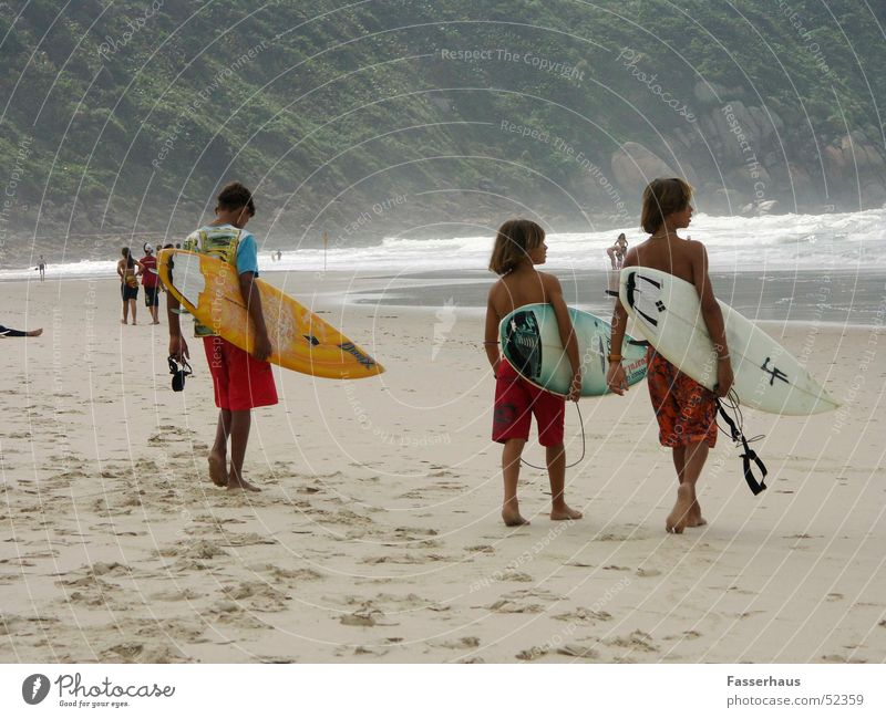 surf kids Surfer Surfing Surfboard Waves Beach Vacation & Travel Brazil Guarujá Sunbathing Child Boy (child) Ocean wave on board vacancy easy Sports Freedom