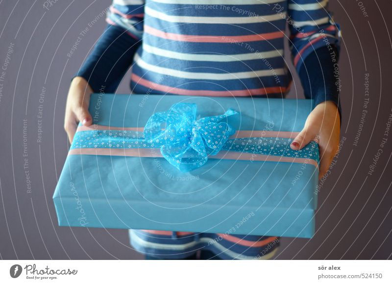 a second Feasts & Celebrations Birthday First day at school Feminine Girl Infancy Upper body Hand 1 Human being Gift Gift wrapping To hold on Blue Happy