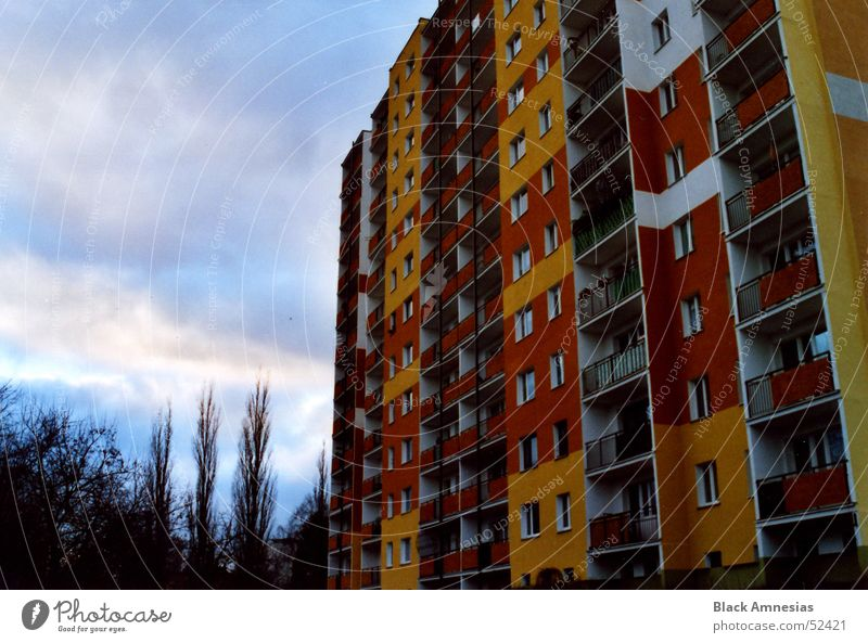 Coloured Tristesse Building Prefab construction Balcony Yellow Red Clouds Tree Might Orange Sky Cover Large Perspective