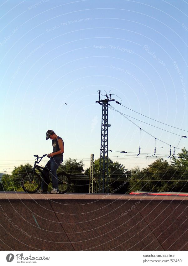 free-style-standing-extreme Freestyle Bicycle Cycle race Man BMX bike Motorcyclist Style Street art Dirt Jumping Overhead line Underground Commuter trains