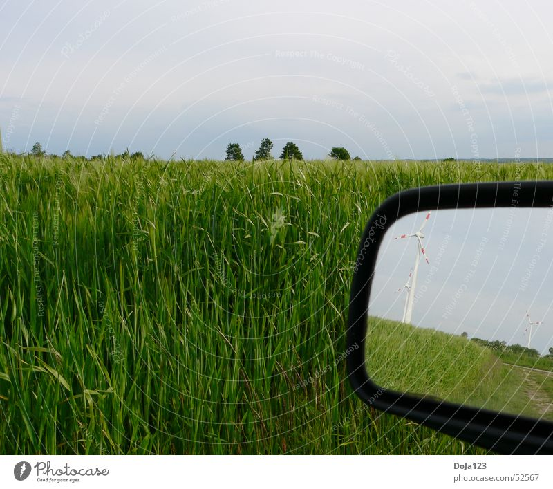 Wind power in the mirror - new energy Field Tree Horizon Clouds Wind energy plant Energy Footpath Grass Mirror Rear view mirror Reflection Stripe Hill Sky