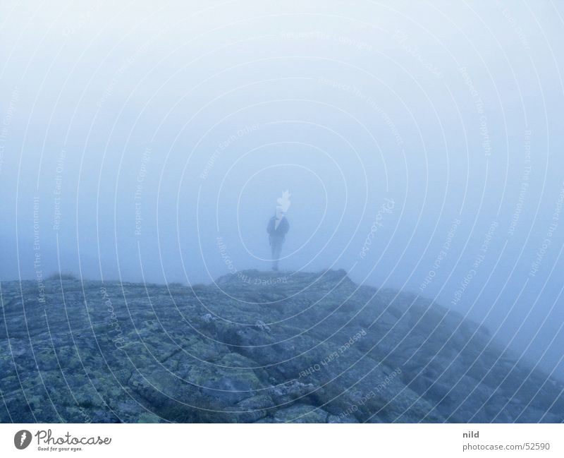 Mountain world without mountain Mountaineering Loneliness Fog Morning Gray Blur Mystic Man Autumn Calm Backpack Disorientated Rock Blue Perspective Escape