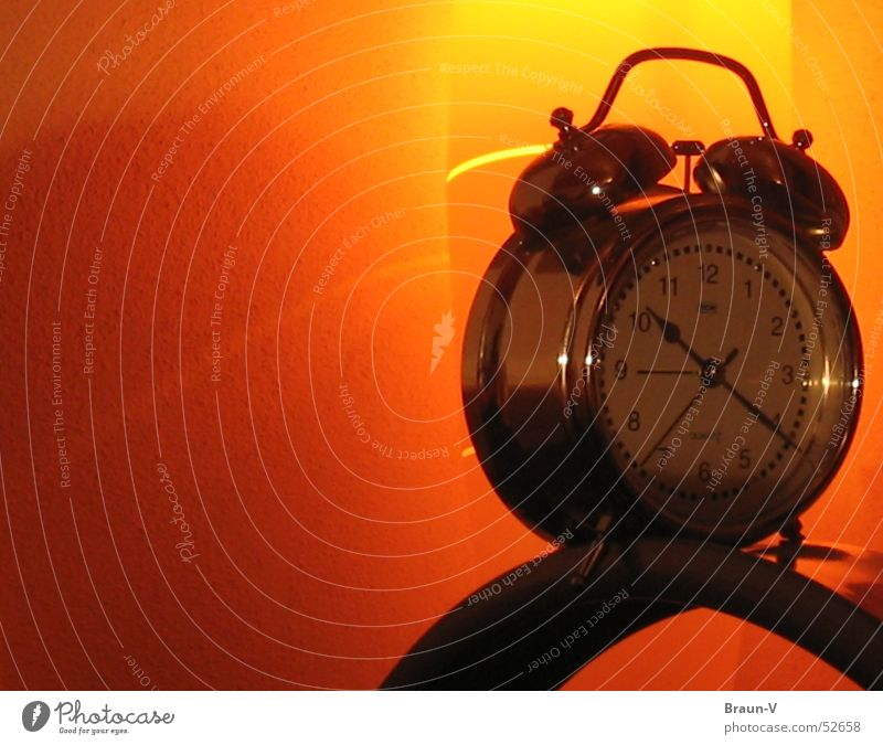 Alarm clock on Height Clock Yellow Light Reflection Wall (building) Orange Silver Clock hand Object photography Isolated Image Bright background Copy Space left