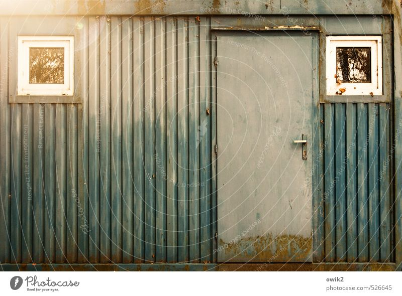 scrap metal Container Wall (barrier) Wall (building) Facade Window Door Metal Illuminate Old Sharp-edged Simple Trashy Gloomy Tin Gray-blue Rust Derelict
