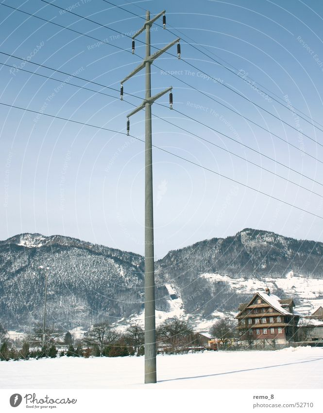 Power_Poles_in_the_snow Electricity Transmission lines Stripe Electricity pylon landscape Idyll Mountain mountains Blue