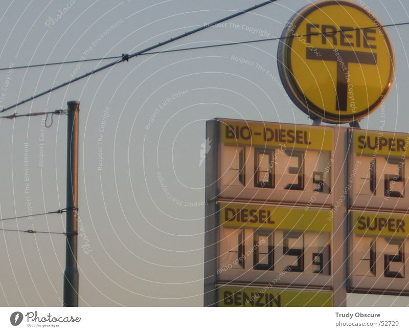 >T< Petrol station Yellow Diesel Liter Gasoline Sky Digits and numbers Cable Great Electricity pylon Blue Signs and labeling Organic produce Price tag