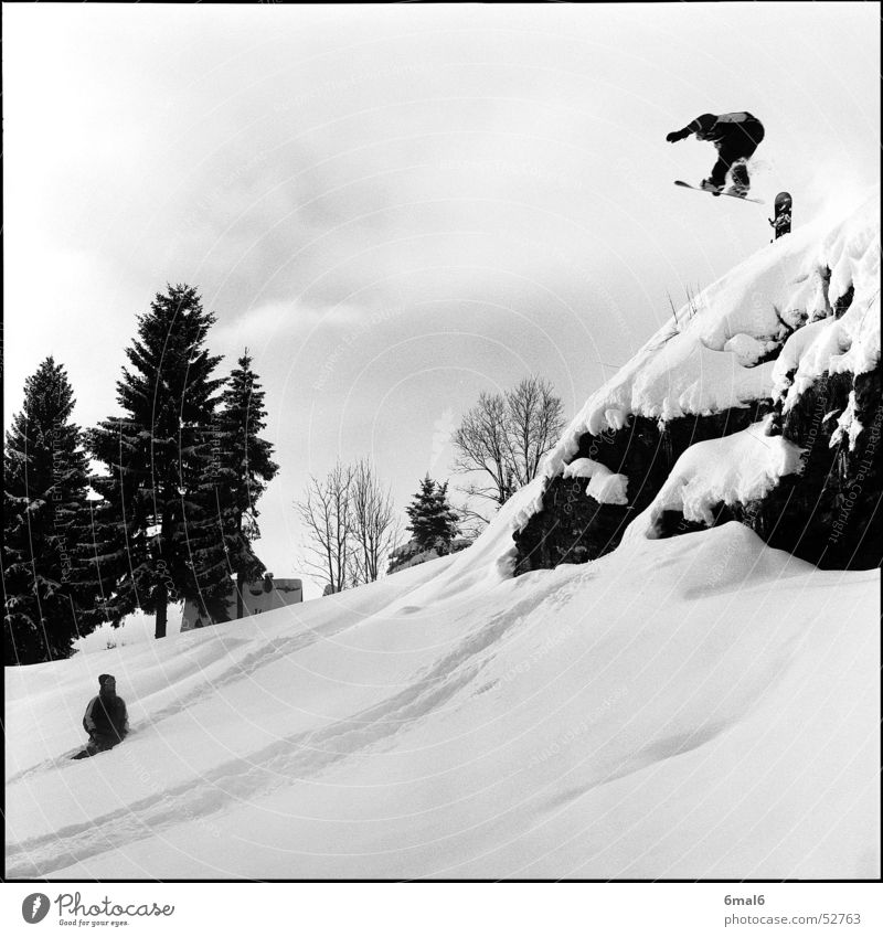 A mess! Winter Snowboard Winter sports White Jump Rock Sports Snowboarder Snowboarding Freestyle Powder snow Deep snow Departure Brave Ledge Black & white photo