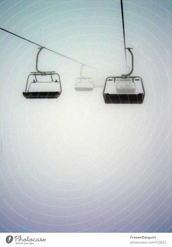 Chair lift to nowhere Fog Dark Ambiguous Hang Dependence Westendorf Federal State of Tyrol Winter Freeze Cold Damp Wire cable Bright Contrast Fear Empty nothing