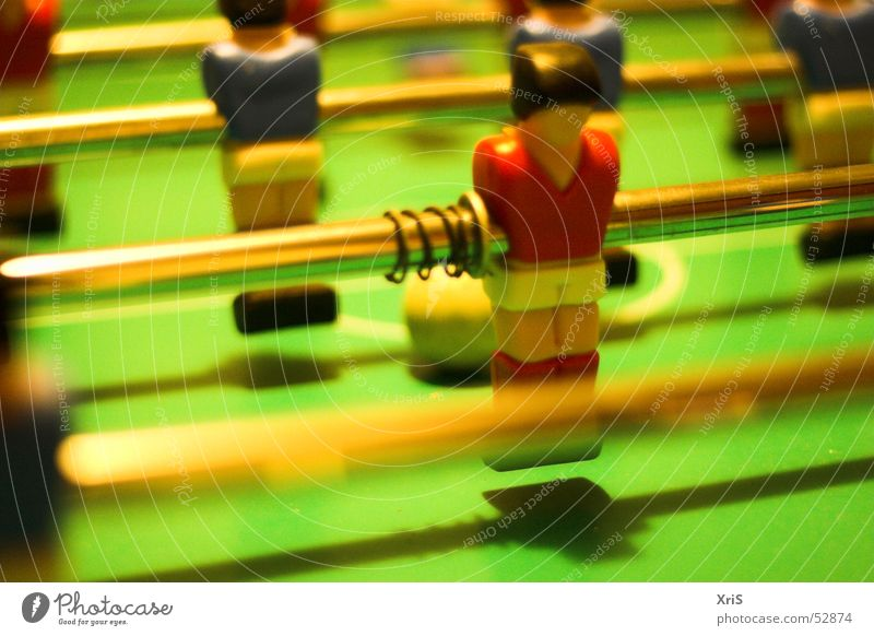 In the second row Table soccer Attacker Sports team Second row Adversary Piece Ball Metal coil Rod Close-up Detail Colour photo Perspective