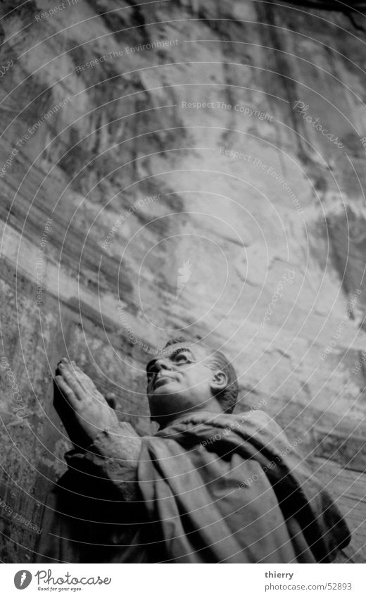 a prayer of stone Statue extolled glasses