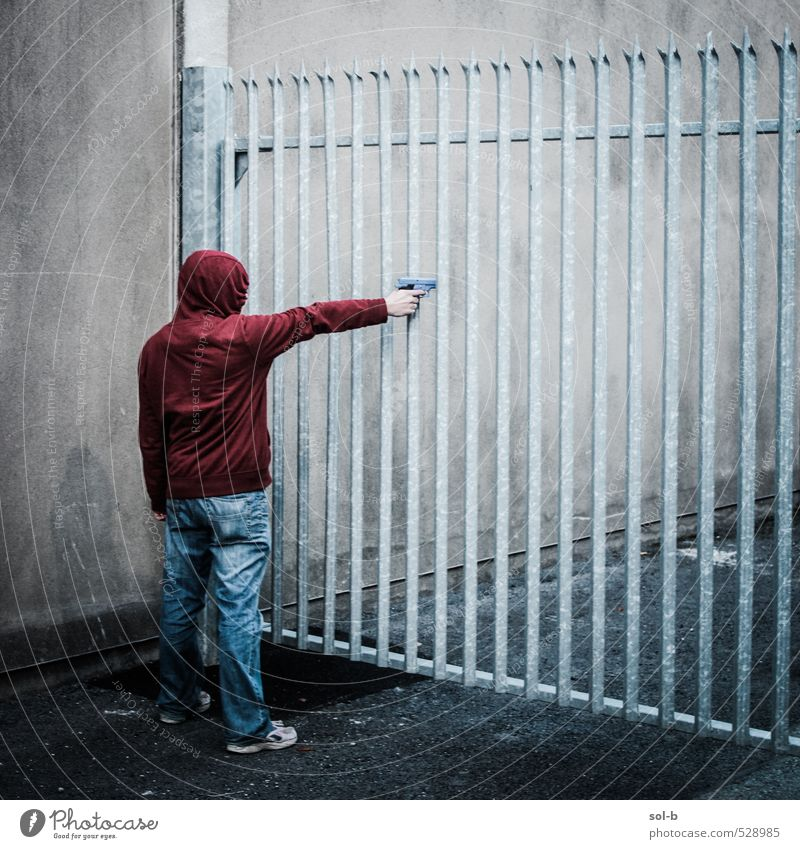 'open up' Human being Youth (Young adults) Man Red Young man Adults Dark Wall (building) Death Wall (barrier) Masculine Dangerous Threat Jeans Barrier Gate