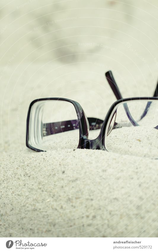 Baltic Sea. Eyeglasses Hip & trendy Sand Beach Spectacle frame Black Lie Relaxation Blind Eye test Colour photo Exterior shot Close-up Deserted Copy Space top