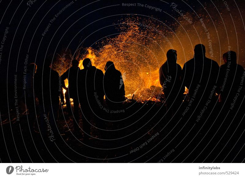 Easter fire Joy Leisure and hobbies Feasts & Celebrations Human being Life Group Crowd of people Historic Blaze Silhouette Night Colour photo Exterior shot