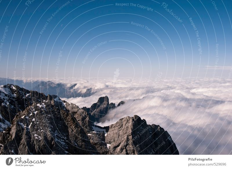 frontiers Climbing Mountaineering Landscape Sky Cloudless sky Clouds Autumn Fog Rock Alps Dachstein mountains Peak Snowcapped peak Threat Gigantic Infinity