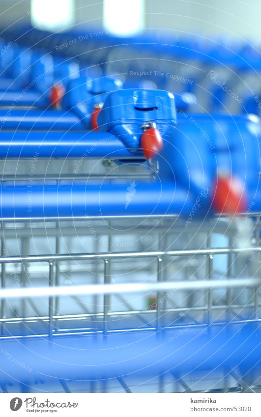 Row Depth of field Section of image Partially visible Shopping Trolley Beaded