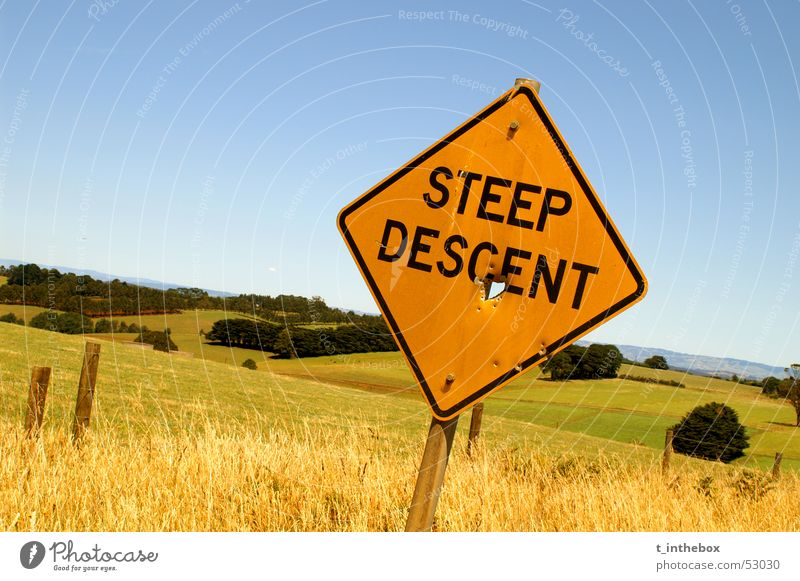 Steep Descent Australia Normal sign gipssland rural Farm landscape nice weather trees field grass Orange blue gree contrast Wide angle