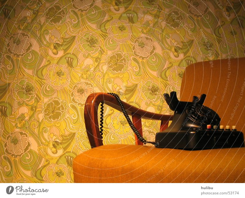 Still no one around? Seventies Sixties Vintage car Retro Armchair Telephone Wall (building) Wallpaper Carpet Brown Green Pattern Floral wallpaper