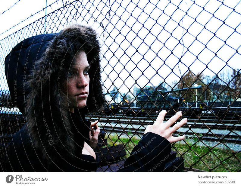 Woman Hand Winter Think Fingers Railroad Model Railroad tracks Train station Fence War Coat Hooded (clothing) Armor-plated Barbed wire Military building