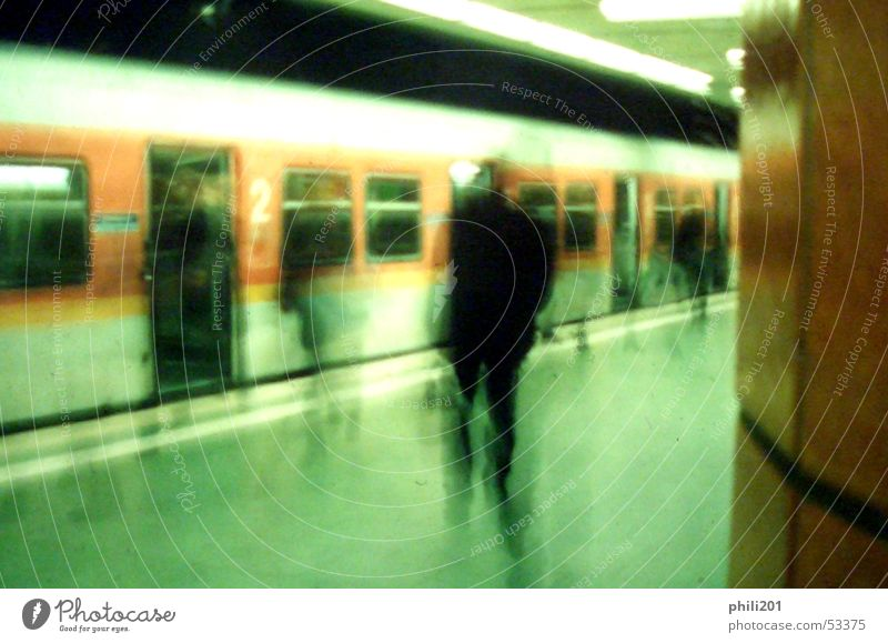 FFM underground. Commuter trains Underground Subsoil Station Hold Stop Motion blur Railroad Frankfurt Loneliness Green Perspective Human being Haste Orange