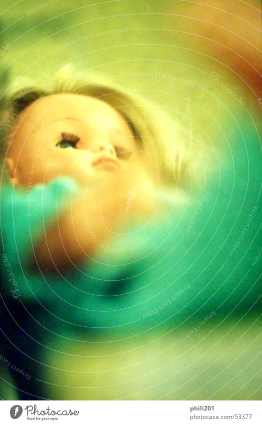 Doll. Neon light Green Blonde Pout Child Woman Toys Turquoise Looking Perspective