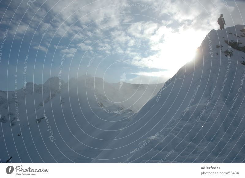 Human being Sky Blue White Sun Clouds Far-off places Snow Mountain Above Small Large Might Alps Easy Skier