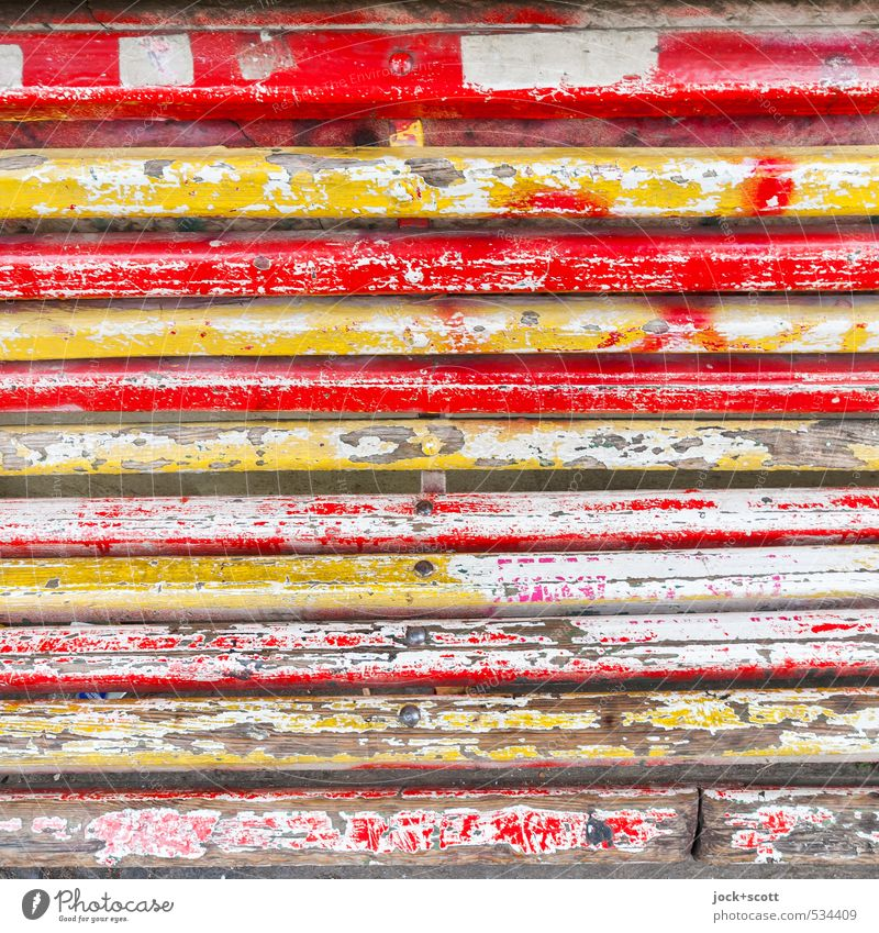 Layer by layer of a wooden bench Old Authentic Retro Yellow Red Decline Transience Change Wooden board Varnish Ravages of time Weathered Multicoloured Detail