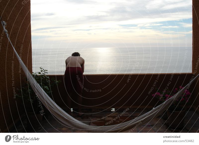 z en ixtapa Sky Summer Swing Relaxation Water Physics Ixtapa clouds sun terrace balcony boy man back sunrise view hamac calm sea ocean Orange color Warmth