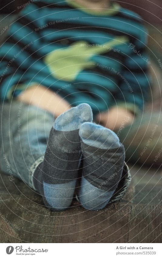 little feet Human being Masculine Toddler Boy (child) Infancy Feet 1 3 - 8 years Child Stockings Relaxation Contentment Leisure and hobbies Goof off Sit
