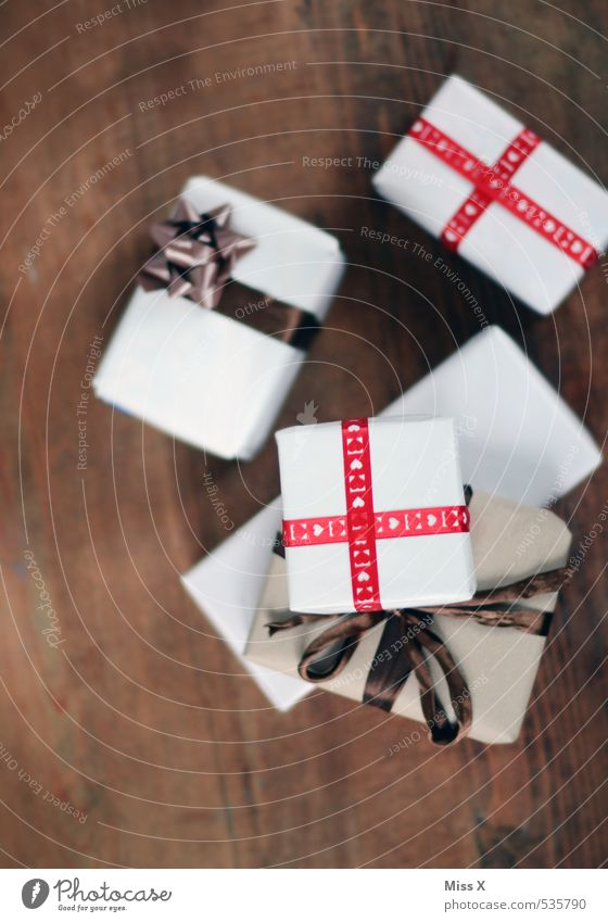 Christmas & Advent Emotions Feasts & Celebrations Moody Birthday Gift Many Stack Anticipation Packaging Bow Package Wooden table Donate Christmas gift