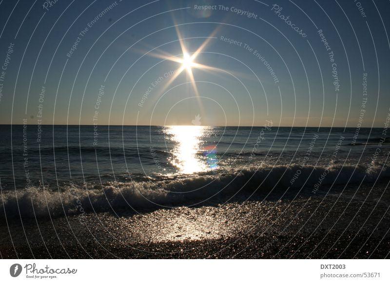 Sunset Beach Flashy Ocean Surf Gravel Waves To break (something) Exterior shot Water Reflection vacation in turkey beautiful sunset