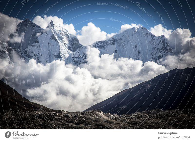 A piece of heaven Nature Clouds Mountain Peak Snowcapped peak Adventure Nepal Himalayas Lunar landscape White Fog Massive Impressive Enormous Colour photo