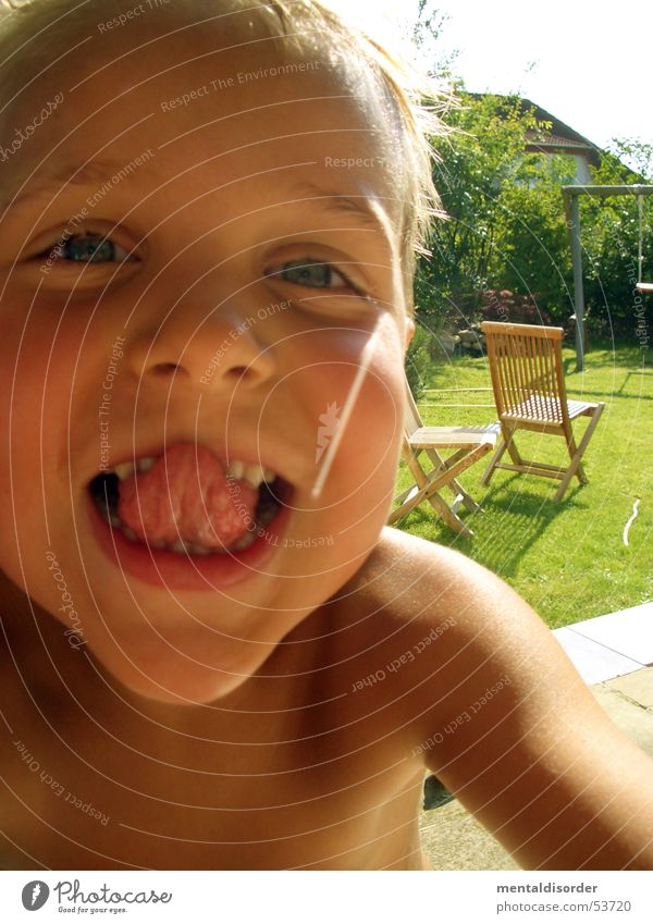 Child Sun Summer Joy Face Eyes Playing Grass Garden Happy Laughter Hair and hairstyles Skin Arm Nose Teeth